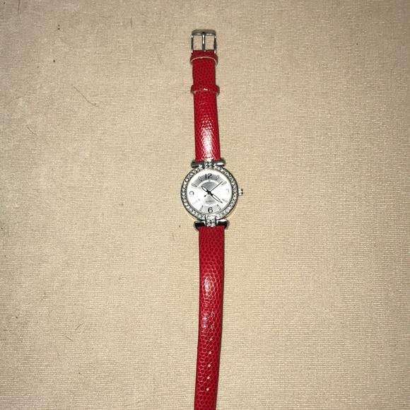 Red Avon watch with rhinestone face